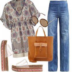 Con una tunica stampata, dei jeans a colonna, degli zoccoletti con la suola di sughero e gli occhiali da sole rotondi, entriamo subito in un mood '70! Perfetto per questa estate, buone passeggiate a tutte!