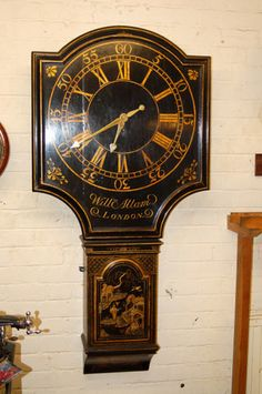 William Allam Tavern clock or Act of parliament clock decorated in fine lacquer work, shield dial