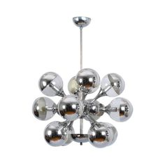 Sputnik Chandelier Reggiani Italia Space Age 1970s | From a unique collection of antique and modern chandeliers and pendants at https://www.1stdibs.com/furniture/lighting/chandeliers-pendant-lights/