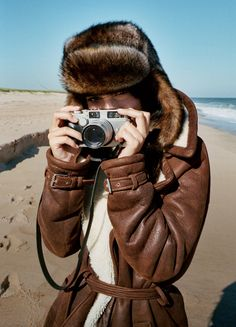 Emily Ratajkowski wears a fur hat with a leather and shearling trench coat photographed by Theo Wenner
