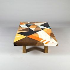 I could get to like a table like this pretty damn fast. Geometric shapes and cool colors on a retro-design table are a wicked combination. The tables were created in a collaboration between East Editions and well-known graffiti artist Vans The Omega. Vans