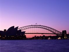 Spectacular deep purple sunset of Sydney harbour silhouetting the Opera House and bridge against a fiery pink glow - free stock photo from www.freeimages.co.uk