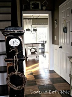 Down to Earth Style: House Tour. I like the colors: tobacco, black and white. The newel post treatment is cute, too.