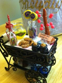Anything from the trolly dears?   Amazingly detailed miniature candy cart straight from the Hogwart's Express.