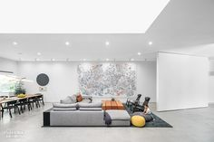 At a Los Angeles house that Dan Brunn Architecture renovated for Chihiro Torikai and her husband, artist James Jean, she relaxes in a walnut-linedalcove, while his...