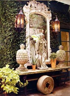 The ivy covering the wall with gas lanterns and old mirror.  Bringing the inside....out