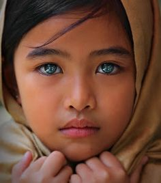 "Pinterest is loaded with these photographs of ""Pipie"" and ""Ivy"" little Southeast Asian girls in veils with dazzling green, blue, turquoise, purple, diamond fiery kaleidoscope eyes . . . . it's called Photoshop and they can all be acredited to Gansforever Osman who apparently has a lot people convinced . . . hmm"
