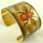 very cool gold bee cuff