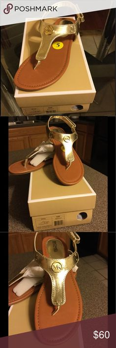 Michael Kors Gold Metallic Sandal Gold metallic Sandal by Michael Kors.  Sandals has fold over Velcro fastener for comfortable, quick closing. Michael Kors Shoes Sandals