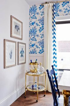 Love the gold bar cart in this blue and white kitchen. Sarah Richardson.