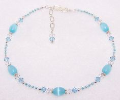 """Baby Blue"" handmade beaded anklet.....Sri Lanka Opal rice beads, Swarovski crystals, glass seed beads, sterling silver spacers, sterling silver beads and findings and a sterling silver clasp."