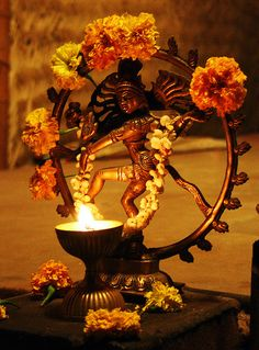 Nataraja, marigolds, fire.