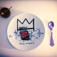 """King Alphonso"" plate, Jean-Michel Basquiat by Ligne Blanche Paris, beauty  check out the entire range of Jean- Michel Basquiat accessories at mademodern.co.uk #Ligneblancheparis #Jeanmichelbasquiat #art #modernart #modern #ModernDesign #decor #design #DecorIdeas #designideas #home #house #homedecor #homeideas #homedesign #homeinterior #Homeaccessories #accessories #plate #Kitchen #Kitchenware #interior #Interiors #InteriorIdeas @ligne_blanche"