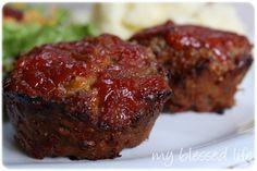 Delicious MINI Meatloaf Recipe 1 egg 1/2 c. milk 1 c. cheese 1/2 c. oats 1/2 t. dried oregano 1/2 t. onion powder 1-2 cloves garlic, minced 1 t. salt 1 lb. ground beef ketchup, mustard, raw sugar {or brown sugar}