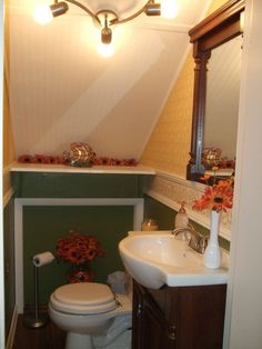 Under the Stairs, Husband and wife team transform under the stairs storage closet into a half bath on a miniscule budget., Under the Stairs After: Half Bath , Bathrooms Design