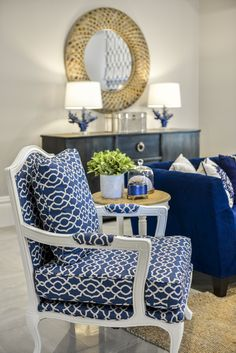 Hamptons style living room featuring a French Louis chair in blue and white fabric.