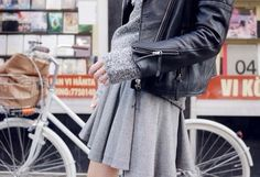 Grey skater skirt, jersey and leather jacket