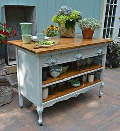 Old dresser as a kitchen island (could be a nice potting bench too!