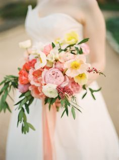 Pink and coral bridal bouquet. Photography: Julie Cate - juliecate.com/  Read More: http://www.stylemepretty.com/2014/09/11/whimsical-pink-wedding-in-austin/