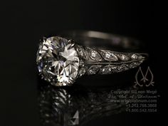 3.00 ct white round diamond;this leaf pattern is very lacy and was originally borrowed from an antique ring
