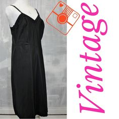 Black vintage slip Satiny vintage slip without any tags so I am guessing ! Very sexy probably polyester size small /medium . Has adjustable straps and eyelet lace on top and bottom edges . Can be worn as a dress too! Bust 34 ,waist 30, hips 36 , length is 40 inches Intimates & Sleepwear Chemises & Slips