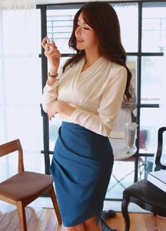 BubbleNchic Shirred Pencil SkirtThis shirred pencil skirt caters to your work wear needs without sacrificing style. High-rise with slight shirred details, designed with an uneven hemline and pencil cut. Pairs well with a blouse and pumps for a classic office outfit.