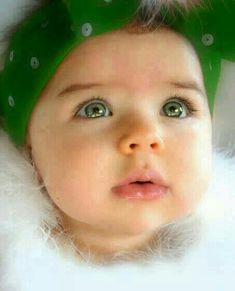 Gorgeous baby girl with green eyes.