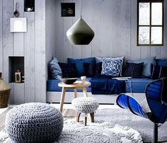 Nice modern interpretation of Moroccan design with it's crochet poufs and Moroccan banquette clad in indigo & cobalt textiles.