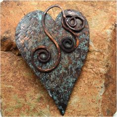 Hand Forged Rustic Copper Heart Pendant Component by SunStones, $16.00  his heart shaped component is made from a sheet of copper which I designed, hand cut with a jeweler's saw, hammered, filed the edges, and oxidized. After those processes were completed, I let the piece sit in a covered container for 24 hours with salt/vinegar/ammonia to give it that beautiful rustic patina. I wire wrapped a swirl from copper wire and torch painted it, attached it to the heart - this functions as a bail.