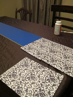 Obviously I would change the girly theme but love the idea of using scrapbook paper--SO much easier than painting.   Girly Kura Bed Hack