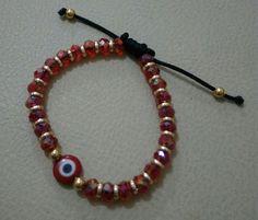 Pulsera en cristales rojos, ojo turco de cristal
