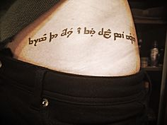 """Elvish for """"from the ashes a fire shall be woken"""". would be cool to get this in elvish but I'd have to really research it to make sure it was accurate Lotr Tattoo, I Tattoo, Fandom Tattoos, Tattoo Ideas, Tattoo Designs, Fellowship Of The Ring, Elvish, Matching Tattoos, Body Modifications"""