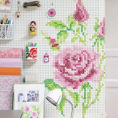 A detailed tutorial on how to build your own pegboard and paint in with a cross stitch pattern.
