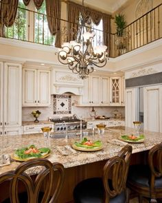 Gorgeous, gorgeous, gorgeous white/ off-white kitchen. I love the beautiful details!!
