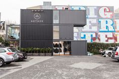 AETHER concept store constructed from three black 8' x 9.6' x 40' shipping containers. San Francisco, CA