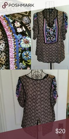 Boho back slit top Mixed print blouse with beading around yoke.  Slit at rear subtly exposes waistline. Gorgeous purples and blues on black.  Excellent condition.  Very Boho chic, purchased from Francesca's boutique. Angie Tops Tees - Short Sleeve