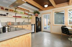 Plywood cabinets, gray counter tops, open shelving modern kitchen @ 2858 S Nevada St Seattle, WA 98108