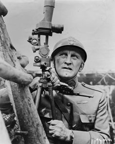 "Kirk Douglas in ""Paths of Glory"", 1957.  Not his first or last entry into the war film arena, ""Paths of Glory"" is director Stanley Kubrick's greatest achievement within the genre, inserting Kirk Douglas's officer, as well as the audience, deep into the psychological and physical horrors of war. This anti-war effort is hailed as Kubrick's masterwork, directly preceding ""Spartacus"", ""Lolita"" and ""Dr. Strangelove"", and it immortalized Douglas as his generation's premiere action star."