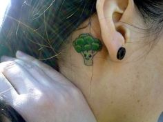 my first tattoo. it was taken as the sign of my vegetarianism. and I think broccoli is very cheerful vegetable. the drawing for this tattoo was made by my boyfriend submitted by vanillamonkey