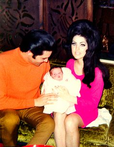 love that dress. love those colors! Elvis & Priscilla with their  daughter, Lisa Marie, February 10, 1968.
