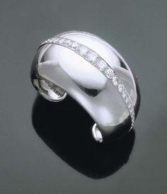 A DIAMOND-SET PLATINUM BRACELET BY SUZANNE BELPERRON, c. 1935.