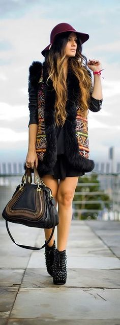 Love this! Though I couldn't get away with that short of a dress or those shoes! that vest is super funky though! - es