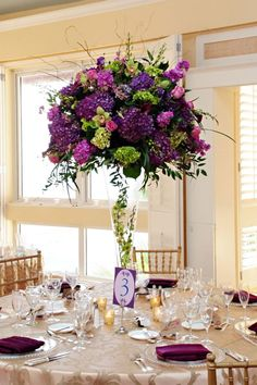 purple and green tall centrepiece