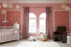 Dress up the ceiling as well as the room. Babies spend a lot of time on their backs looking up. Treat the whole room as a giant mobile by hanging paper lanterns, parasols or string lights.