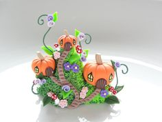 Miniature fairy pumpkin house village with pretty flowers and toadstools by fizzyclaret