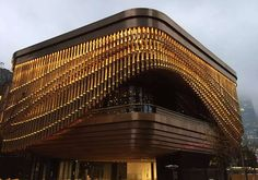 The Arts and Cultural Centre, Shanghai Bund Financial Centre, China. Showing the moving veil of the Arts and Cultural Centre in Rose Gold PVD tubular drops. - Developer: Shanghai Zendai Bund International Finance Center Real Estate co. Ltd - Architect: Foster & Partners; Heatherwick Studio