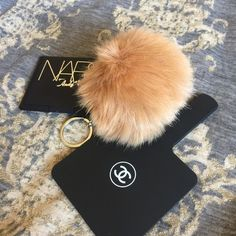 """NEW COFFEE SOFT FUZZY POM POM SILVER KEYCHAIN FOB NEW! So soft! Color: Coffee. With silver hardware and key ring. 5"""" long.NO TRADES OR QUESTION COMMENTS FROM NON SERIOUS BUYERSDO NOT BUNDLE UNLESS YOU INTEND TO BUYDO NOT LOWBALL & NO PRICE COMMENTSPRICE IS REFLECTED ON PM FEES AND HOW MUCH I PAID Boutique Accessories Key & Card Holders"""