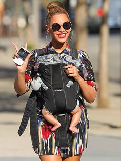 After riding the Caribbean waves, Beyoncé Knowles returns to mommy mode with 3-month-old Blue Ivy in New York's Central Park.