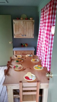 Table and cabinets in the playhouse