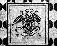 Gorgoneion (head of Medusa) in room 11 of The House of the Gorgons in Ostia, which may have been an undertakers'. Black and white mosaic, Roman, early 4th century AD.